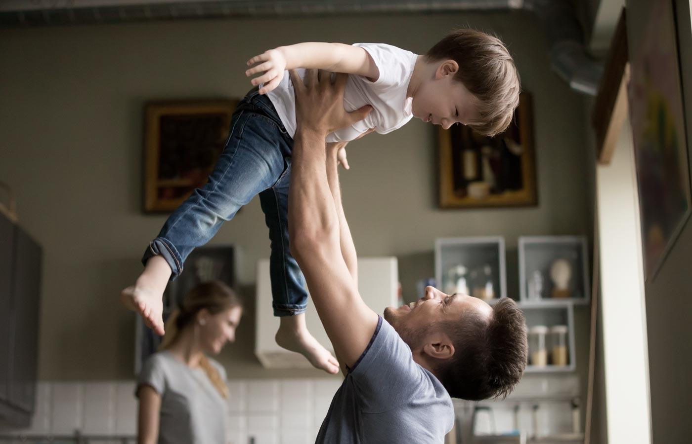 dad holding kid